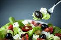 Enjoying a healthy Greek salad Royalty Free Stock Photo