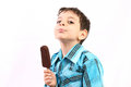 Enjoying an icecream boy isolate on white Royalty Free Stock Photos