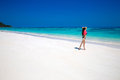 Enjoying life healthy woman walking on exotic sea fit brunette girl blue sky tropical beach outdoor summer portrait bliss Stock Photography