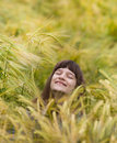 Enjoying life young girl in wheat field smiling face Stock Photo