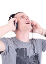 Enjoying the music close up of a happy young man with headphones studio shot Royalty Free Stock Image