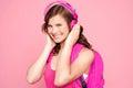 Enjoying music schoolgirl smiling Royaltyfria Bilder