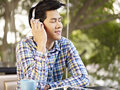 Enjoying music young man eyes closed Stock Images