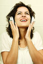 Enjoying music a young woman listening with headphones Royalty Free Stock Photos