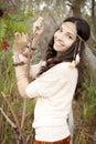 Enjoying nature boho girl holding onto branches Royalty Free Stock Images