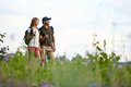 Enjoying nature portrait of two trippers standing in the countryside at summer Stock Photos