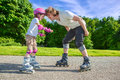 Enjoying roller skating father and daughter Stock Image