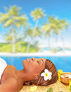 Enjoying spa resort portrait of cute african woman sleeping on massage table on the beach day luxury summer vacation pleasure and Royalty Free Stock Photos