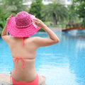 Enjoying a swimming pool rear view of asian woman relaxing in the Royalty Free Stock Photos