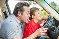 Enjoying time together father gives his son driving lessons Royalty Free Stock Image