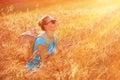 Enjoying wheat field on sunset beautiful traveler girl golden in light beautiful summer nature farmland in europe travel and Stock Image
