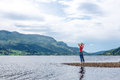 Enjoyment free happy woman enjoying landscape norway in a summer cloudy day freedom happiness and concept Royalty Free Stock Images