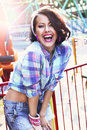 Enjoyment gladness expressive woman in checkered shirt with toothy smile happy blue fanfair Stock Image