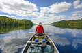 Enjoyng the wilderness canoer on kekekabic lake in boundary waters in minnesota Stock Image