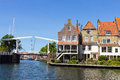 Enkhuizen holland houses and a draw bridge in the netherlands the city was once one of the harbour towns of the voc Royalty Free Stock Images