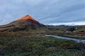Enlightened mountaintop at sunrise in skogar iceland Royalty Free Stock Photos