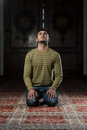 Enlightment muslim man is praying in the mosque Stock Image