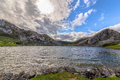 Enol lake surrounded by mountains on a cloudy day in asturias spain Royalty Free Stock Photo