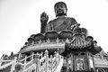 The enormous Tian Tan Buddha Big Buddha in black and white color in Hong Kong Royalty Free Stock Photo
