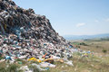 Enormous trash wave near fields landfill crop Stock Photography