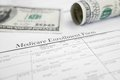 Enroll in medicare enrollment form and money Royalty Free Stock Photo