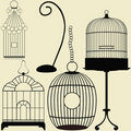 Ensemble de quatre cages d'oiseau de wintage Image stock