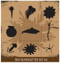 Ensemble de symboles abstrait d animaux de mer de silhouette d isolement Images stock