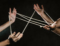 Entangle hands tied with a rope Stock Images