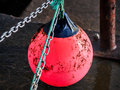 Entangled with a buoy broken loose during stormy weather becomes in chains at the seafront Stock Images