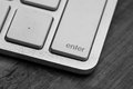 Enter key on the computer on wooden background Royalty Free Stock Photography