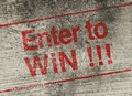 Enter to win concept text is painted on old fashion wall Royalty Free Stock Images