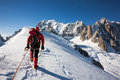 Enterprise diligence team work mountaneering concepts mountaneer climbs a snowy ridge in mont blanc france Stock Image