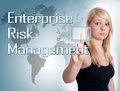 Enterprise risk management young woman press digital button on interface in front of her Royalty Free Stock Photos