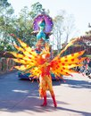 Entertainers in colorful costumes participating in DisneyWorld parade