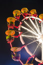 Entertainment park attraction at night colorful carousel lights in amusement Royalty Free Stock Image