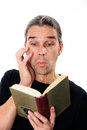 Enthralling book man is reading a Royalty Free Stock Image