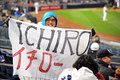Enthusiastic fan of ichiro suzuki huge ishiro yankees baseball player in pinstripe uniform number Royalty Free Stock Photos