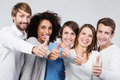 Enthusiastic group of people giving a thumbs up multiethnic motivated smiling young success and approval Royalty Free Stock Photo
