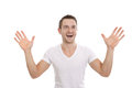 Enthusiastic happy man with hands up isolated in white Royalty Free Stock Images