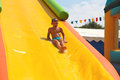 Enthusiastic kid on slide