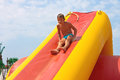 Enthusiastic kid on slide in the waterpark Royalty Free Stock Photography