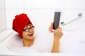 Enthusiastic woman in bathtub with tablet computers close up Royalty Free Stock Images