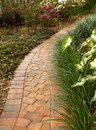 Enticing curved garden path winds around a beautiful Royalty Free Stock Image