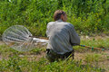 Entomologist the with butterfly net on meadow Royalty Free Stock Image