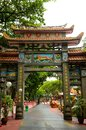 Entrance arch to haw par villa park singapore december the and path the in the theme contains over statues and Royalty Free Stock Images