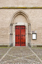 Entrance door of saint walburg church wooden with decorative fittings in arch shaped wall recess the walburga in the hanse town Royalty Free Stock Photos