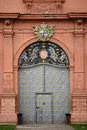 Entrance electoral palace mainz germany september the door of the studded with gold iron ornaments and a coat of arms on Royalty Free Stock Image