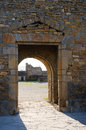 Entrance in the medieval boundary wall sunlit gateway of ainsa Royalty Free Stock Photos
