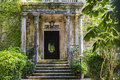 Entrance of an old mansion with garden Royalty Free Stock Photo