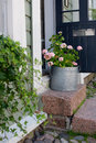 Entrance of old wooden building in porvoo finland sunny summer day city flowers on the stairs outside Royalty Free Stock Photography
